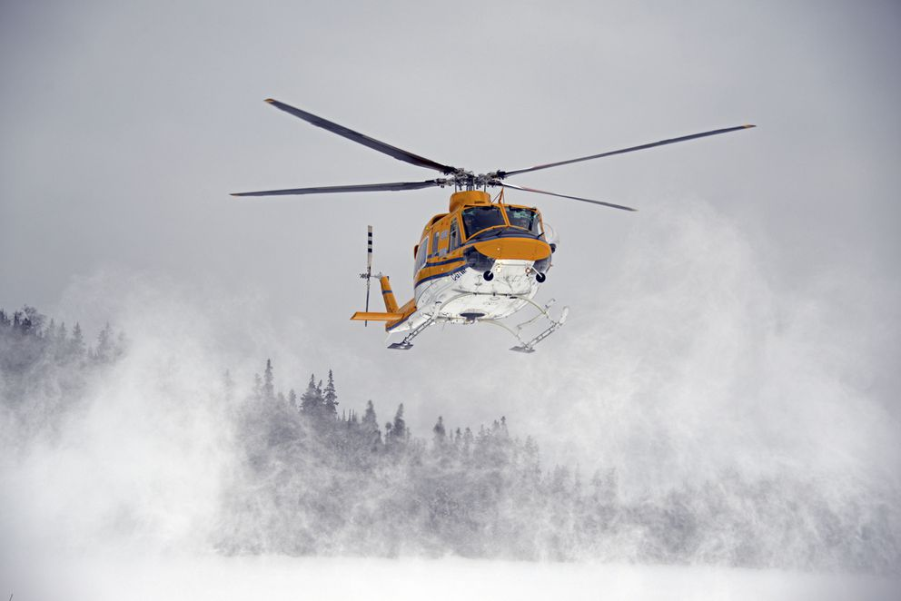 A Canadian helicopter transporting sedated caribou lands on Slate Island, in Lake Superior. (Ontario Ministry of Natural Resources and Forestry via The New York Times)