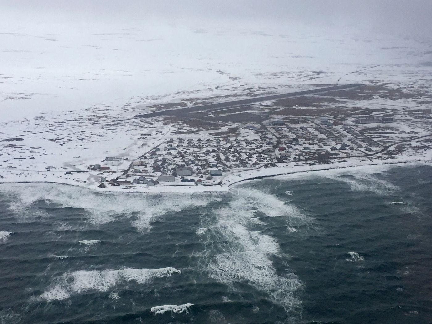 Waves break near the shore in Savoonga inApril. (Marc Lester / Alaska Dispatch News)