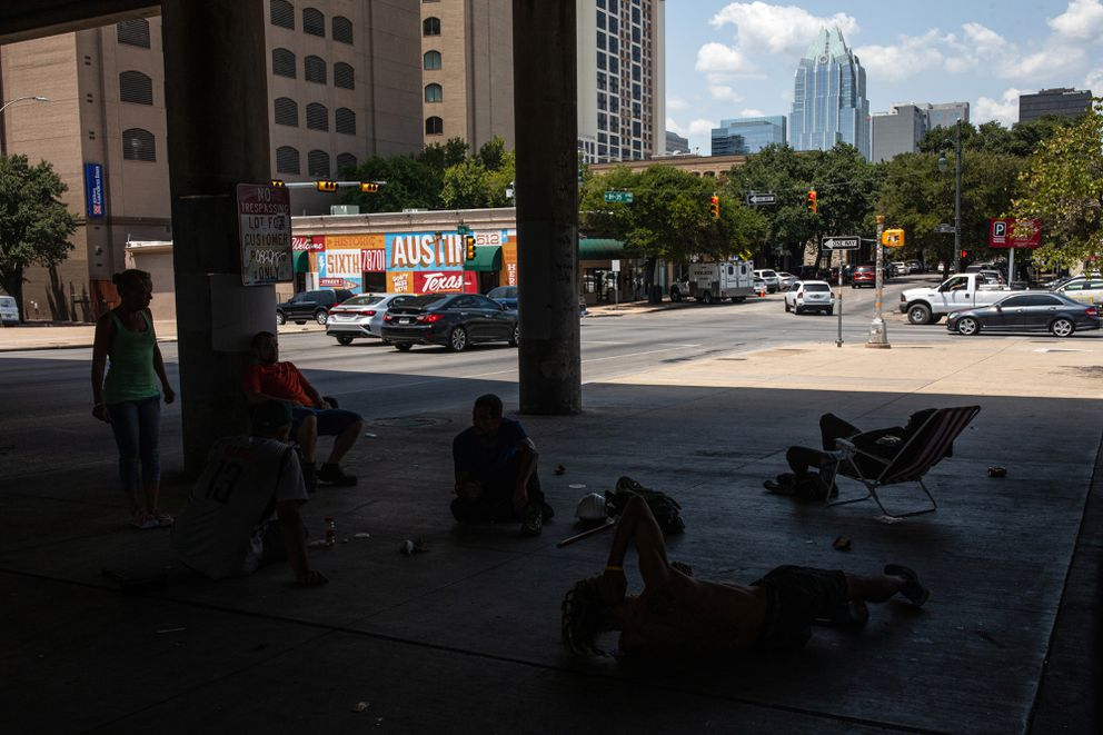 Homeless people near downtown Austin stay in the shade of the interstate. Photo by Tamir Kalifa for The Washington Post.