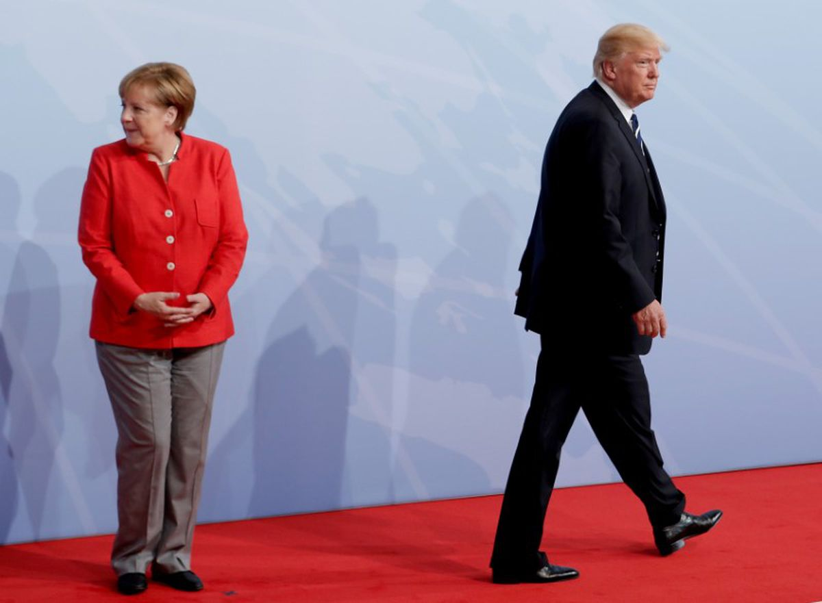 German Chancellor Angela Merkel welcomes U.S. President Donald Trump to the opening day of the G20 leaders summit in Hamburg, Germany, July 7, 2017. REUTERS/Ian Langsdon/Pool