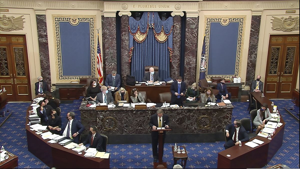 In this image from video, Michael van der Veen, an attorney for former President Donald Trump, listens as the clerk read a question from Sen. Bill Cassidy, R-La., during the second impeachment trial of former President Donald Trump in the Senate at the U.S. Capitol in Washington, Friday, Feb. 12, 2021. (Senate Television via AP)