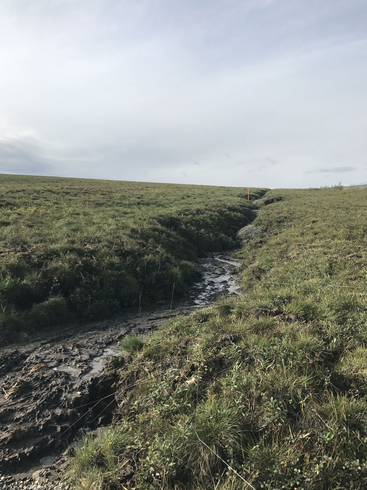 Erosion has plagued stretches of cable installed alongside the Dalton Highway for two companies, GCI and Quintillion. This section is near Mile 350 of the highway, about 60 miles south of where it ends at Prudhoe Bay. (Alaska Department of Environmental Conservation)