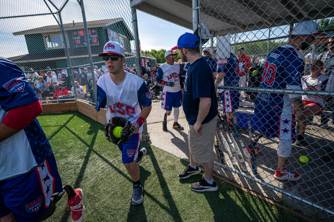 USA Patriots outfielder Scotty Fura, Jr. heads out of the dugout during a game against the Momma's Boys at the 2021 Pot of Gold Tournament on Saturday, June 12, 2021 at Cartee Fields in Anchorage. Fura, 18, is the only player on the team who did not serve in the military. (Loren Holmes / ADN)