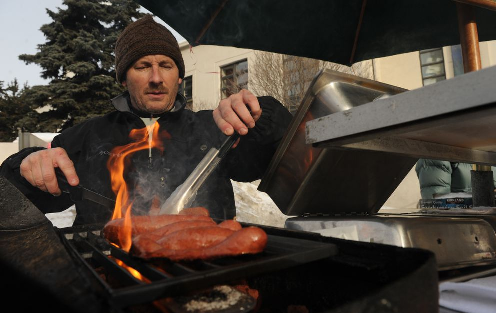 Michael Anderson opens his M.A.s Gourmet Dogs cart in spring 2012.  (Bob Hallinen / ADN)