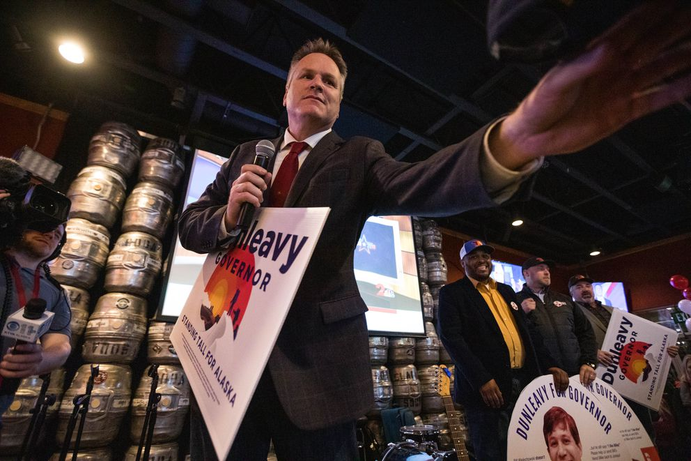 Mike Dunleavy reaches for a campaign hat during a speech thanking an Independent Expenditure group that supported his gubernatorial candidacy, at a republican party celebration Tuesday, Nov. 6, 2018 at the Anchorage Alehouse. (Loren Holmes / ADN)