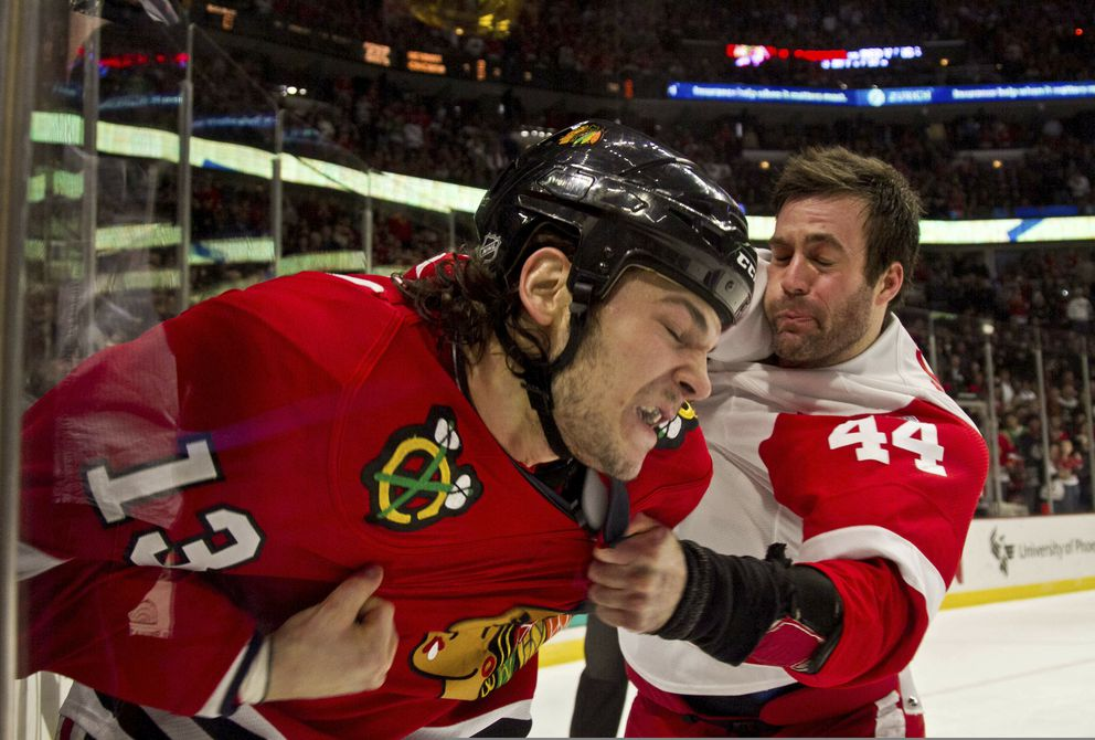 Chicago Blackhawks' Daniel Carcillo and Detroit Red Wings' Todd Bertuzzi fight during the first period of an NHL hockey game in Chicago in 2011. (AP Photo/Charles Cherney, File)