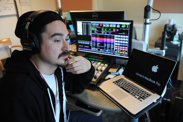 The director of the new online radio station RIVR, James Dommek Jr., poses in the control room at Koahnic Broadcast Corp. in Anchorage, Alaska on Thursday, October 5, 2017. (Bob Hallinen / Alaska Dispatch News)