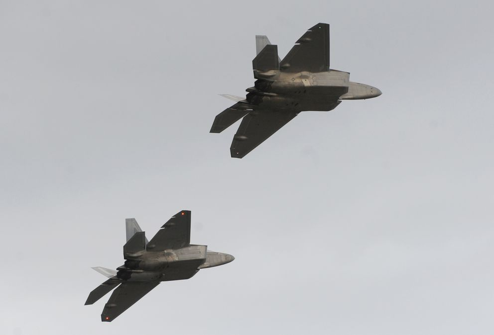 F-22 Raptors flythe airspace over Joint Base Elmendorf-Richardson in2011. (Bill Roth / ADN archive 2011)