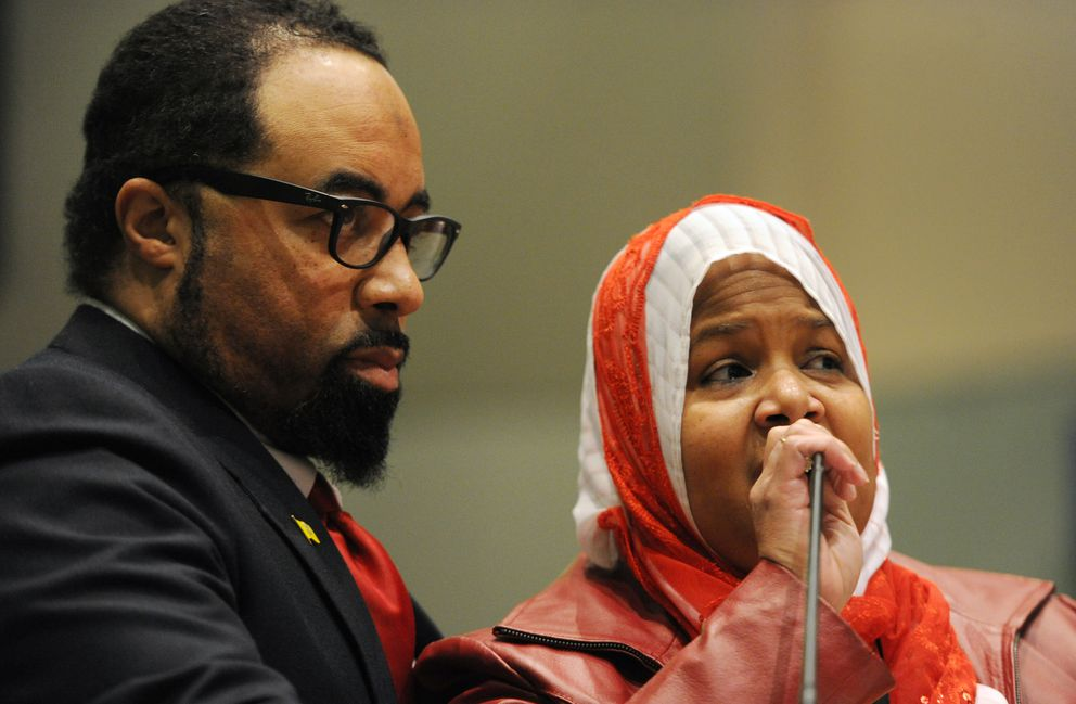 Gregory Jones, an electrician and former candidate for a Mat-Su Valley state House seat, and his wife Maleika Jones speak to the Anchorage Assembly on Tuesday about comments Assemblywoman Amy Demboski made about them and how they are now living in fear. (Bill Roth / Alaska Dispatch News)
