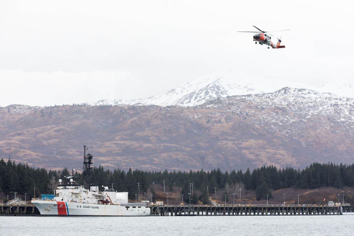 A HH-60J Jayhawk helicopter passes the cutter Alex Haley at the Kodiak Coast Guard Base on Thursday, Jan. 24, 2019. (Loren Holmes / ADN)
