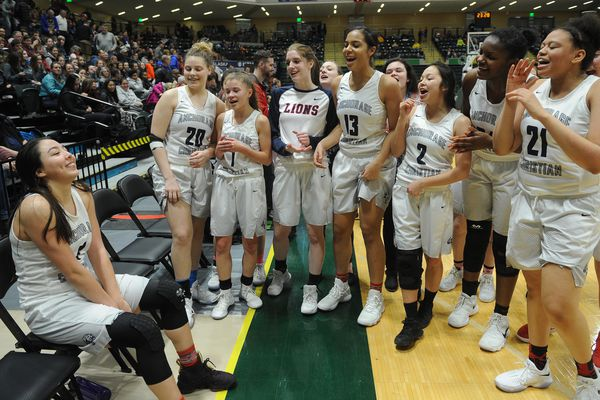 Anchorage Christian team and fans sing happy birthday to Destiny Reimers, sitting, after their win over Sitka 56-46 in the championship game of the 3A girls Alaska State basketball tournament at the UAA Alaska Airlines Center in Anchorage, Alaska on Saturday, March 24, 2018. (Bob Hallinen / ADN)