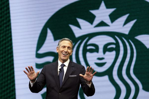 FILE - In this March 22, 2017 file photo, Starbucks CEO Howard Schultz speaks at the Starbucks annual shareholders meeting in Seattle. Schultz spent more than 30 years at Starbucks, growing a handful of coffee shops into a much-admired global brand. But now, as the billionaire mulls running for president as an independent, Starbucks will have to tread carefully. (AP Photo/Elaine Thompson, File)