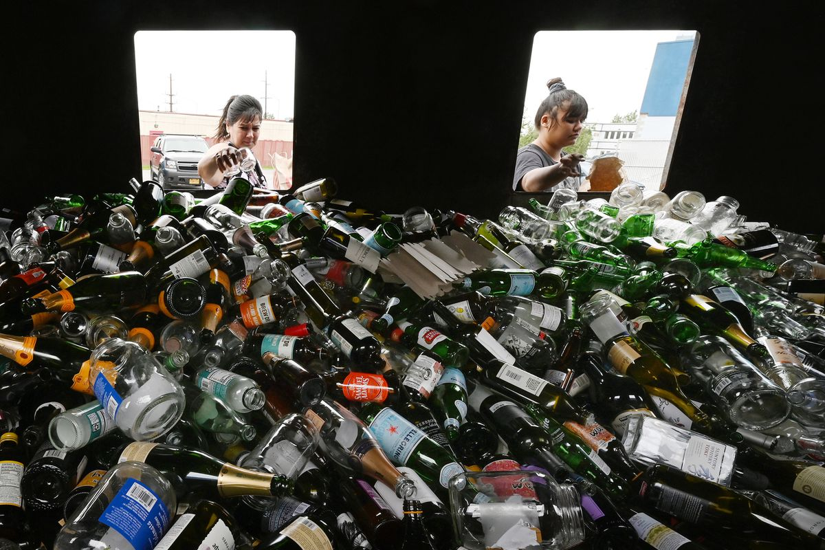 Christine and Sarina Lee drop off glass at the WestRock Anchorage Recycling Center at 6161 Rosewood Street on Tuesday, July 20, 2021. (Bill Roth / ADN)
