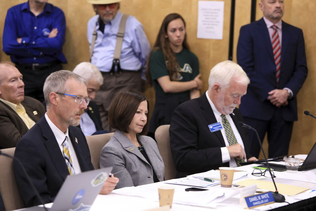 From left, University of Alaska Fairbanks Chancellor Daniel White, UA Anchorage Chancellor Cathy Sandeen and UA Southeast Chancellor Rick Caulfield speak at a UA Board of Regents meeting, Tuesday, July 30, 2019, in Anchorage, Alaska. Facing severe budget cuts, regents voted 8-3 to authorize UA President Jim Johnsen to immediately reduce administrative costs and prepare a plan for a transition from three accredited institutions to one. (AP Photo/Dan Joling)
