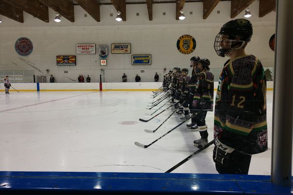 The South Wolverines line up for introductions at Wednesday night's hockey game between South and Dimond at Ben Boeke Ice Arena on Dec. 13, 2017. (Daily News photo by Stephan Wiebe)