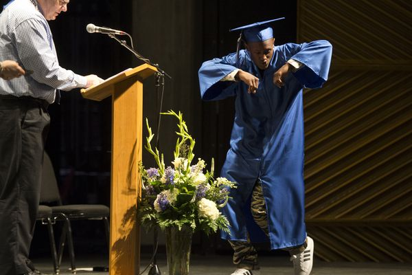 Leslie Harris dances onto the stage when his name is announced. S.A.V.E. High School recognized 51 graduates at a ceremony at the Alaska Center for the Performing Arts on May 22, 2018. (Marc Lester / ADN)