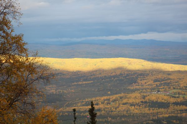 The afternoon sun, through a break in the clouds, lights up a Fairbanks hillside Monday Sept. 11. (Dermot Cole/Alaska Dispatch News)
