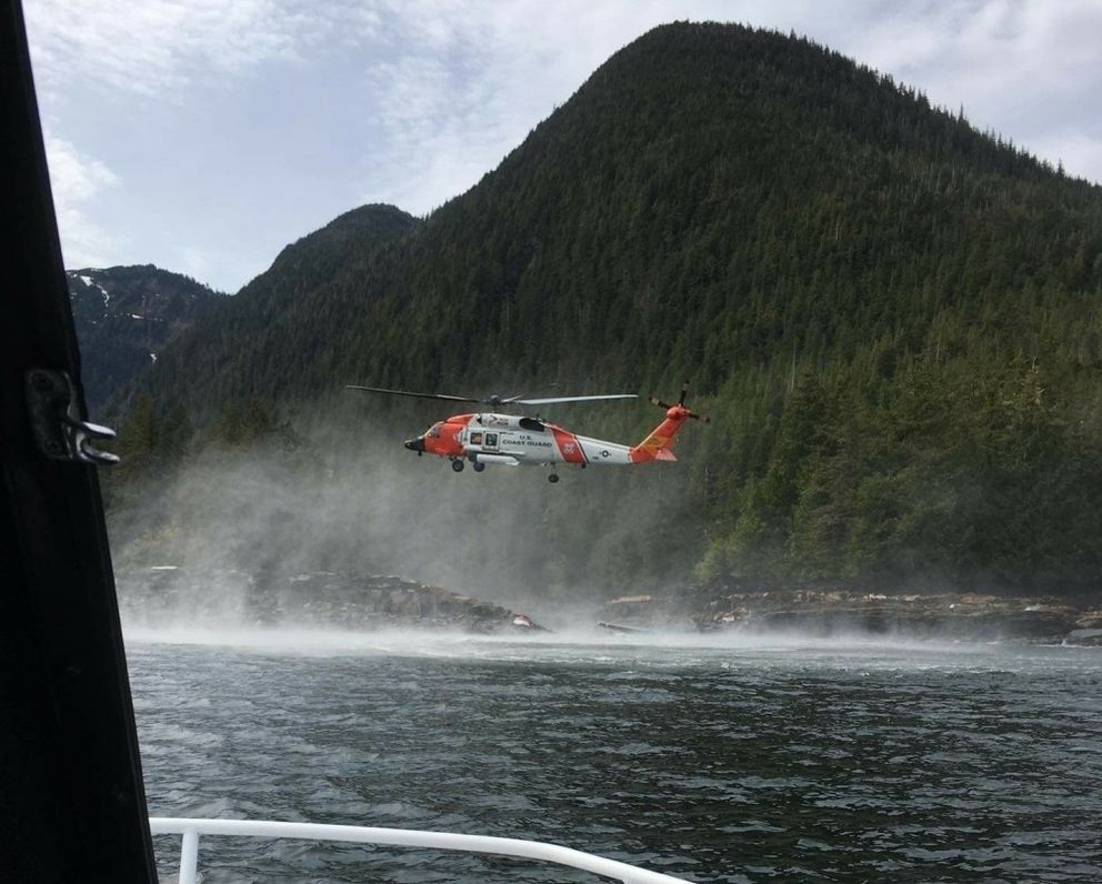 A Coast Guard Air Station Sitka MH-60 Jayhawk helicopter crew hovers while searching for a survivor from a report of two aircraft colliding in George Inlet near Ketchikan, Alaska, Monday, May 13, 2019. Ten of the 11 people aboard one of the planes swam to shore and were rescued by Coast Guard aircrews. (Photo courtesy of Ryan Sinkey via U.S. Coast Guard)