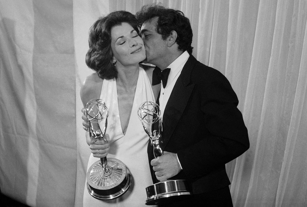 FILE - Peter Falk of 'Columbo ' gives Jessica Walter of 'Amy Prentice ' a kiss after both won Emmys on May 19, 1975. Walter won for best actress in a limited series while Falk was named best actor in a lined series. (AP Photo, File)
