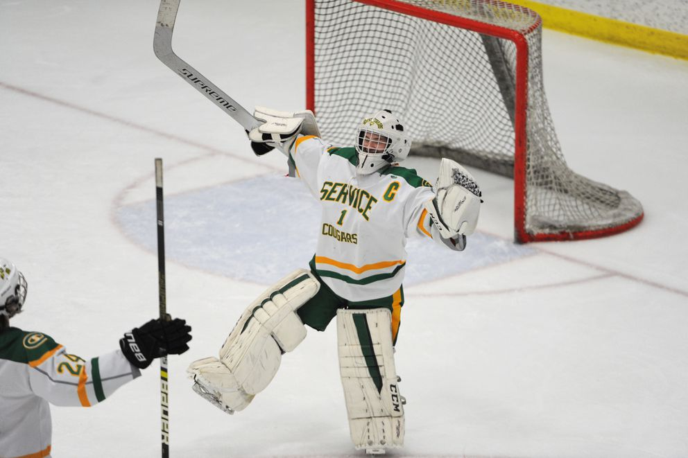 Service goaltender Kevin Taunton celebrates the Cougars' 6-1 victory over the Colony Knights during the state hockey championships at the Menard Center in Wasilla on Thursday, Feb. 7, 2019. (Bill Roth / ADN)