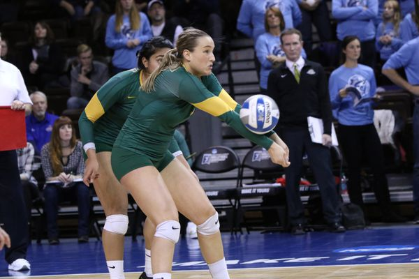 Leah Swiss of UAA sets the ball in the final minutes of their semifinal match with Palm Beach Atlantic at the NCAA D-II tournament in Sioux Falls, SD. (Michael G Brown)