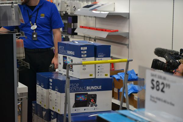 OPINION: Fosters kids need stability and care in their lives, and there are ways all of us can help. Pictured: A Best Buy worker loads 17 laptops bound for teens in foster care in December 2014. The laptops were bought with donations to the group Facing Foster Care in Alaska.
