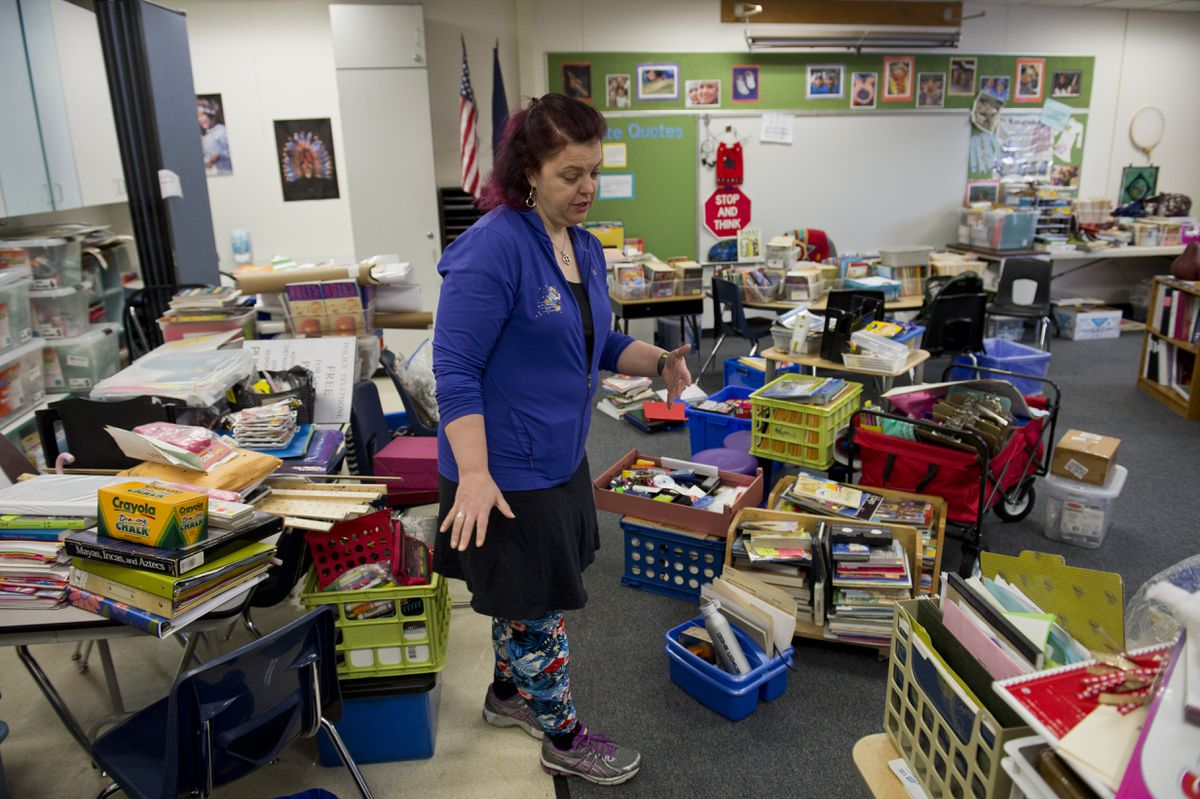 Fourth grade teacher Heather Helgeson said she is sorting through items taken out of her fire-damaged classroom to see what can be kept on Jan. 2, 2018, days after fire damaged the room. (Marc Lester / ADN)