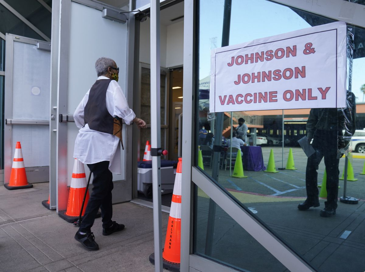 "FILE - In this April 1, 2021 file photo, people walk in to get their COVID-19 vaccine at the Baldwin Hills Crenshaw Plaza in Los Angeles. The U.S. is recommending a ""pause"" in administration of the single-dose Johnson & Johnson COVID-19 vaccine to investigate reports of potentially dangerous blood clots. In a joint statement Tuesday, the Centers for Disease Control and Prevention and the Food and Drug Administration said it was investigating clots in six women in the days after vaccination, in combination with reduced platelet counts. (AP Photo/Damian Dovarganes)"