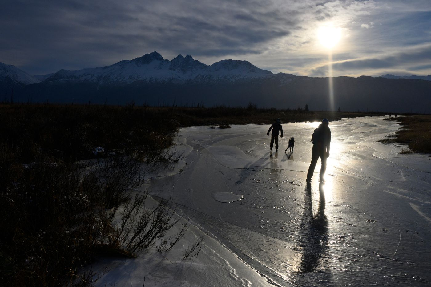 Ice skaters take advantage of snow-free conditions on Wasilla Creek in Palmer Hay Flats State Game Refuge on November 5, 2020. (Marc Lester / ADN)