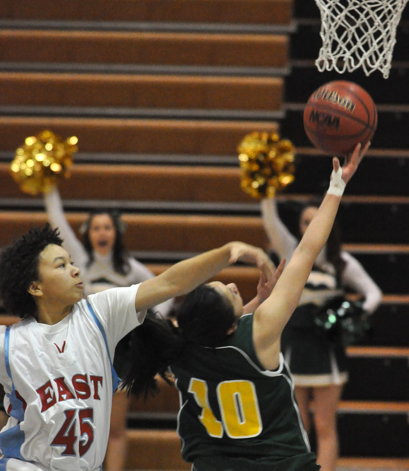 Dajonee Hale of East High reaches over as Krysta Sumabat Service goes up for the shot during the first half of girls Basketball action at East High on Wednesday January 21, 2009. (Bob Hallinen / ADN)