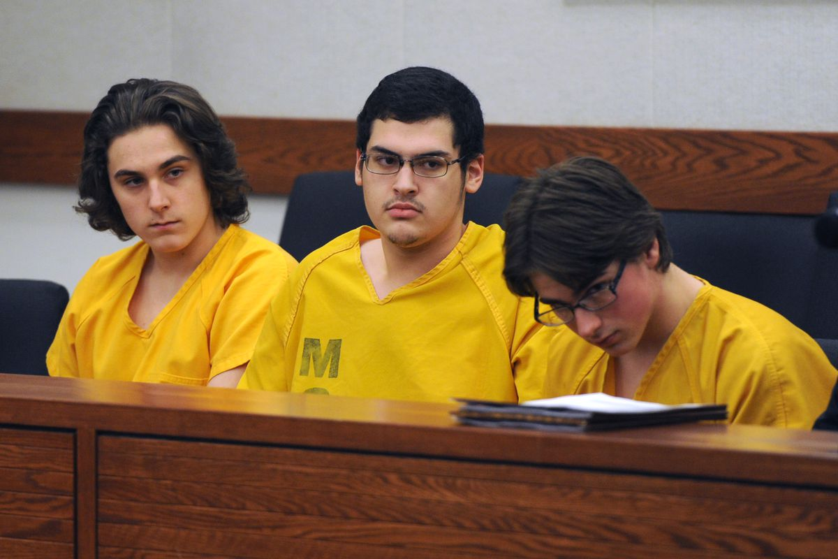 From left, Austin Barrett, Dominic Johnson and Bradley Renfro appear for arraignment on additional charges in the David Grunwald murder case on Tuesday morning in Palmer Superior Court. (Erik Hill / Alaska Dispatch News)