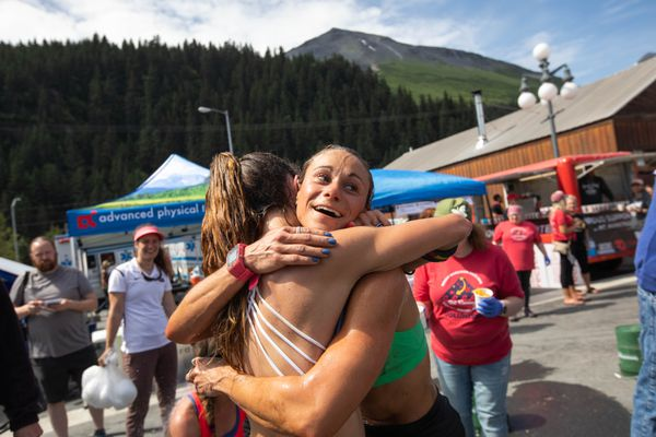Mount Marathon women's winner Jessica Yeaton gets a hug from second place Denali Foldager-Strabel after the race Wednesday, July 4, 2018 in Seward. (Loren Holmes / ADN)