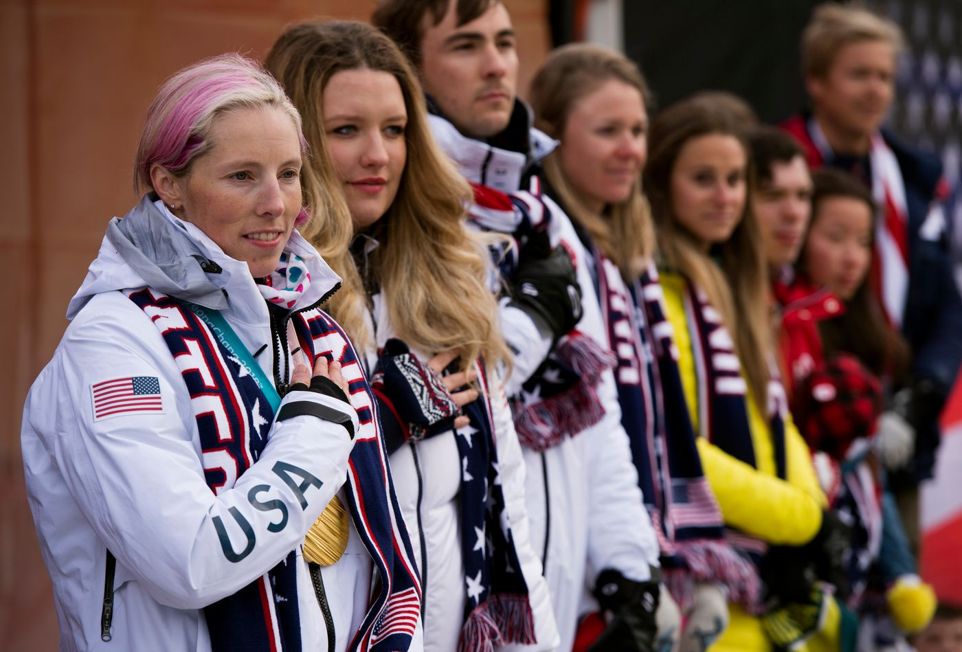 Kikkan Randall, left, stands with several other Alaskan Olympians who were recognized in Town Square on April 4, 2018. Hundreds of Alaskans filled Town Square Park in Anchorage, Alaska, for a celebration of gold medal winner Kikkan Randall and the state's other Winter Olympians who competed in Pyeongchang, South Korea. Photograpahed on April 4, 2018. (Marc Lester / ADN)