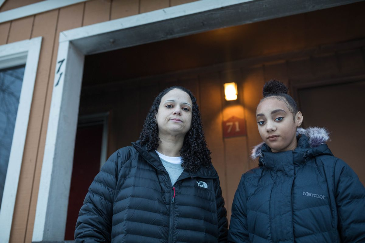 Rebecca Hatley and her daughter Aniah Hatley, 13, stand outside their fire-damaged home Saturday in Anchorage. Hatley, a dental anesthesia assistant, was sedating a patient on Nov. 30 when the magnitude 7.0 earthquake struck, causing a gas pipe to break, which started a fire in her apartment. (Loren Holmes / ADN)