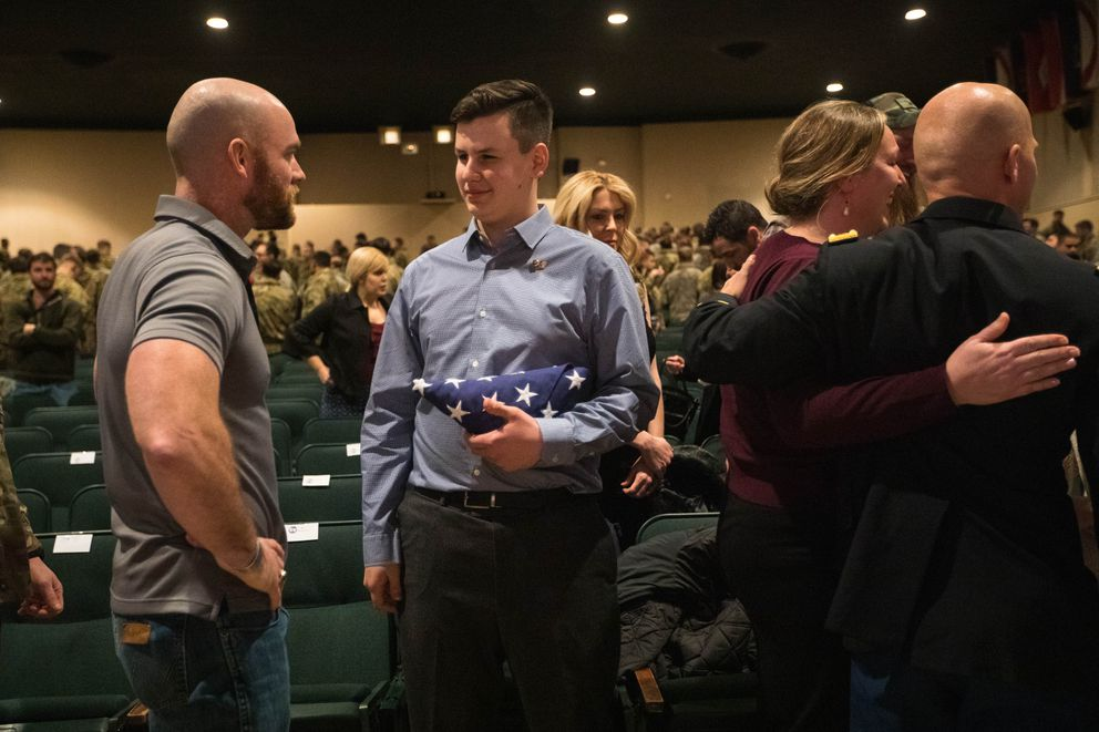 Staff Sgt. Ty Carter, left, a Medal of Honor recipient, speaks with MacAiden Gallegos after the Distinguished Service Cross award ceremony Saturday. (Loren Holmes / ADN)