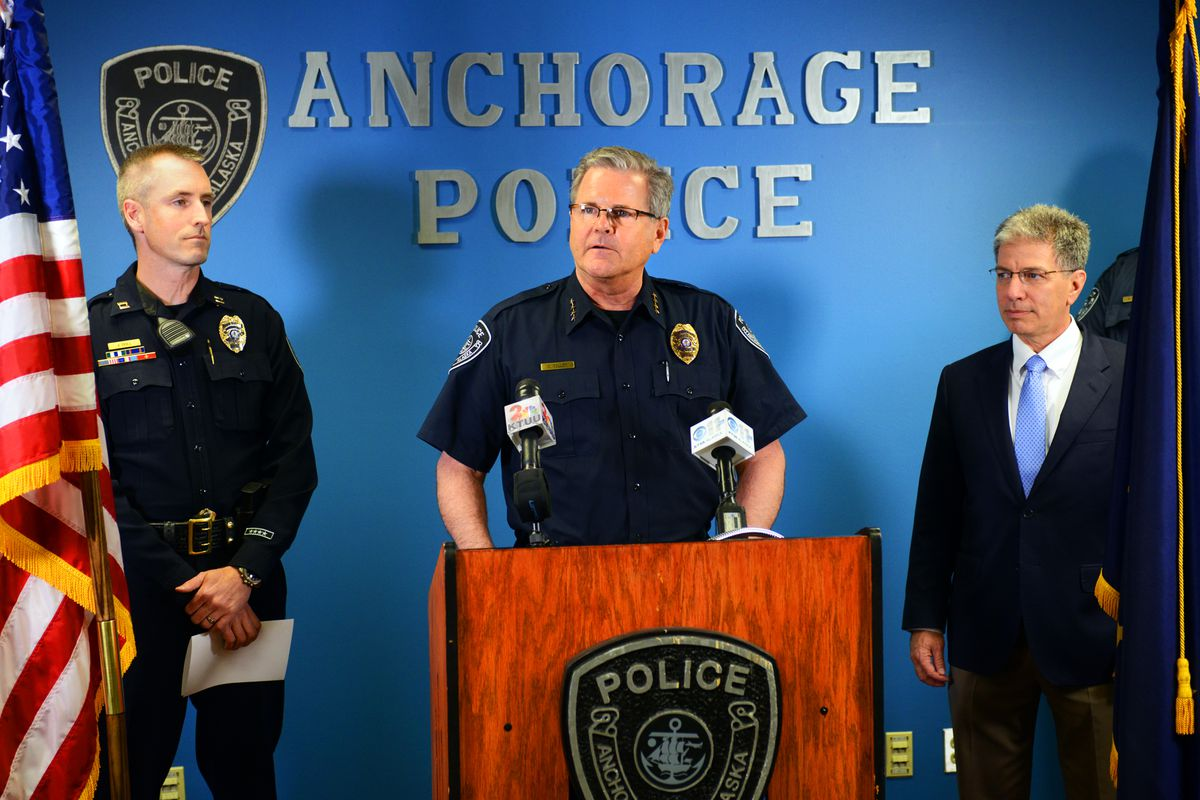 Chief Chris Tolley announces his upcoming retirement while flanked by Mayor Ethan Berkowitz, right, and his successor Capt. Justin Doll on Monday afternoon at Anchorage Police Department headquarters. Tolley will retire June 30. (Erik Hill / Alaska Dispatch News)