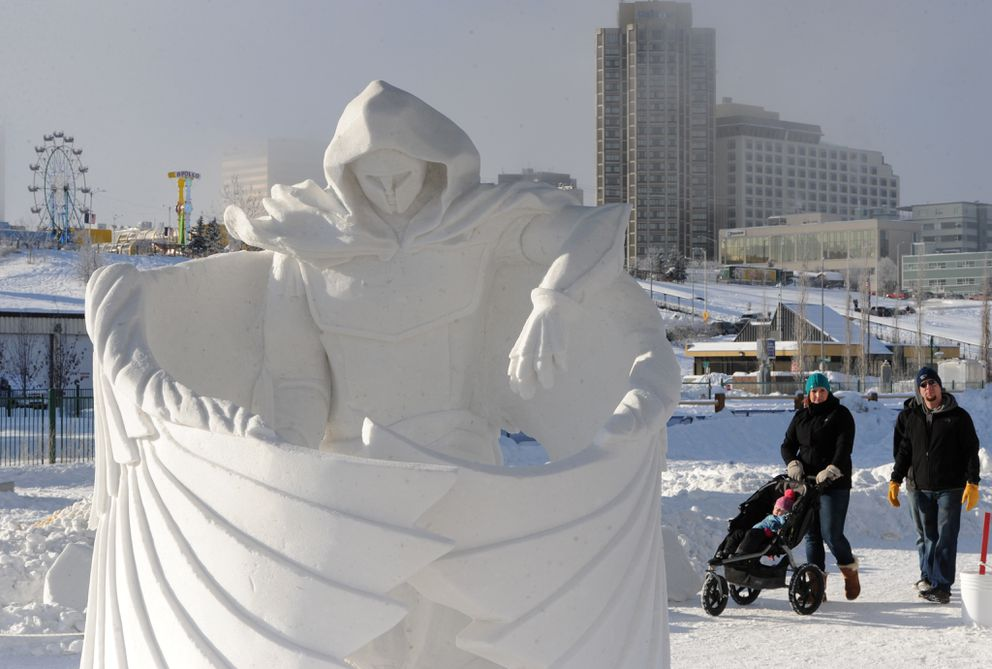 """Guardian Angel"" by AK Awesome won the Team of Three division during judging of the Alaska State Snow Sculpture Championship on Sunday, Feb. 25, 2018, during the Fur Rondy winter festival earning them a trip to the U.S. National Snow Sculpture Competition. (Bill Roth / ADN)"