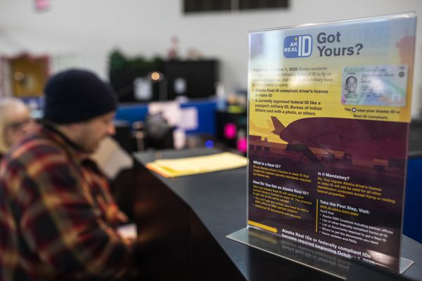 A poster informs people of the availability of the Alaska Real ID, on Wednesday, Jan. 2, 2019 at the Anchorage DMV office. (Loren Holmes / ADN)
