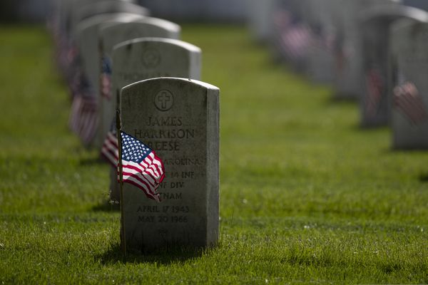 American flags are placed by members of the 3rd U.S. Infantry Regiment, also known as The Old Guard, in front of each headstone for