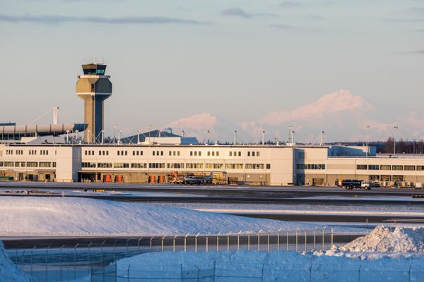 Denali is seen behind the Ted Stevens Anchorage International Airport control tower on Friday, Jan. 11, 2019. (Loren Holmes / ADN)
