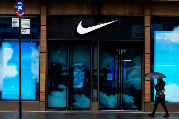A pedestrian passes a closed Nike store in the SoHo neighborhood of New York on March 17, 2020. MUST CREDIT: Bloomberg photo by Demetrius Freeman