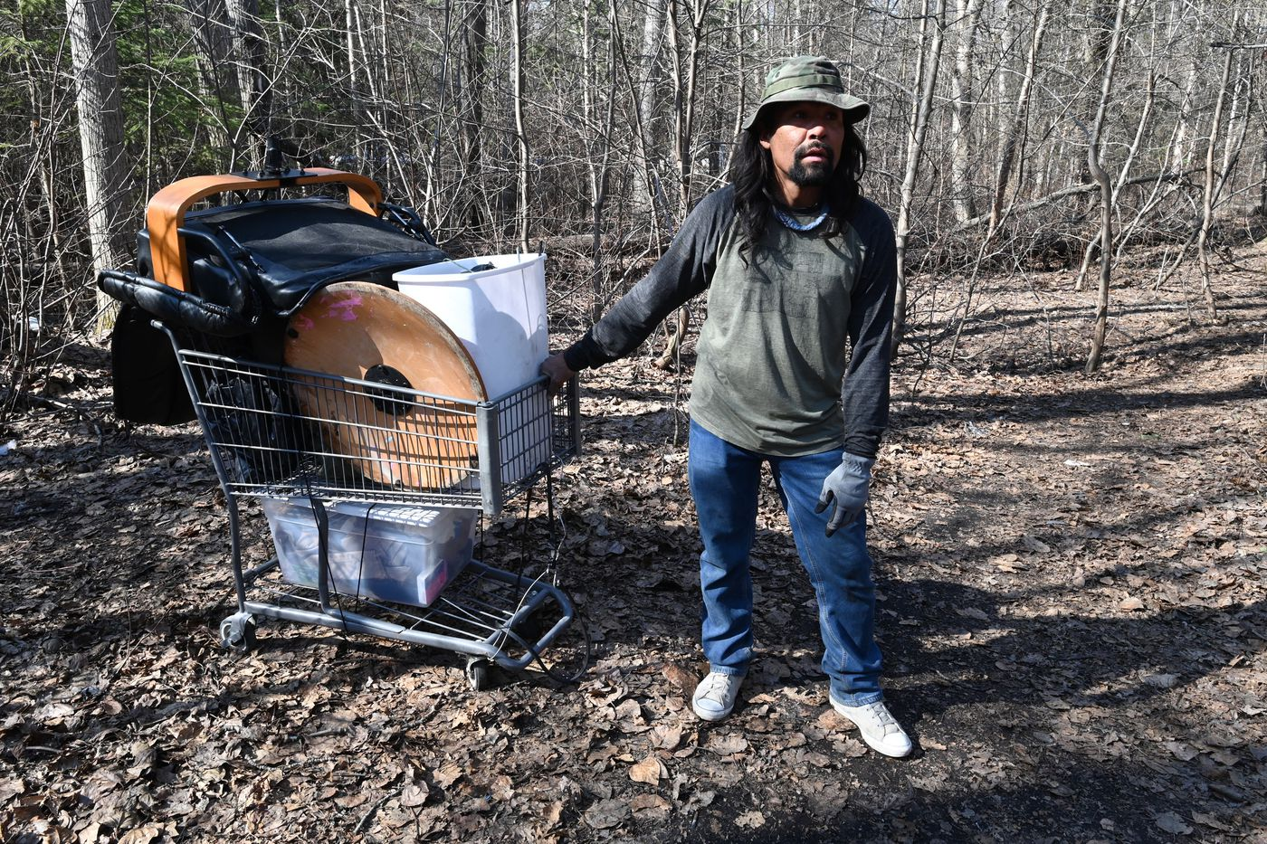 Gil Jacko hauls some possessions to a homeless campsite along Chester Creek on Thursday, April 30, 2020, during the COVID-19 pandemic. (Bill Roth / ADN)