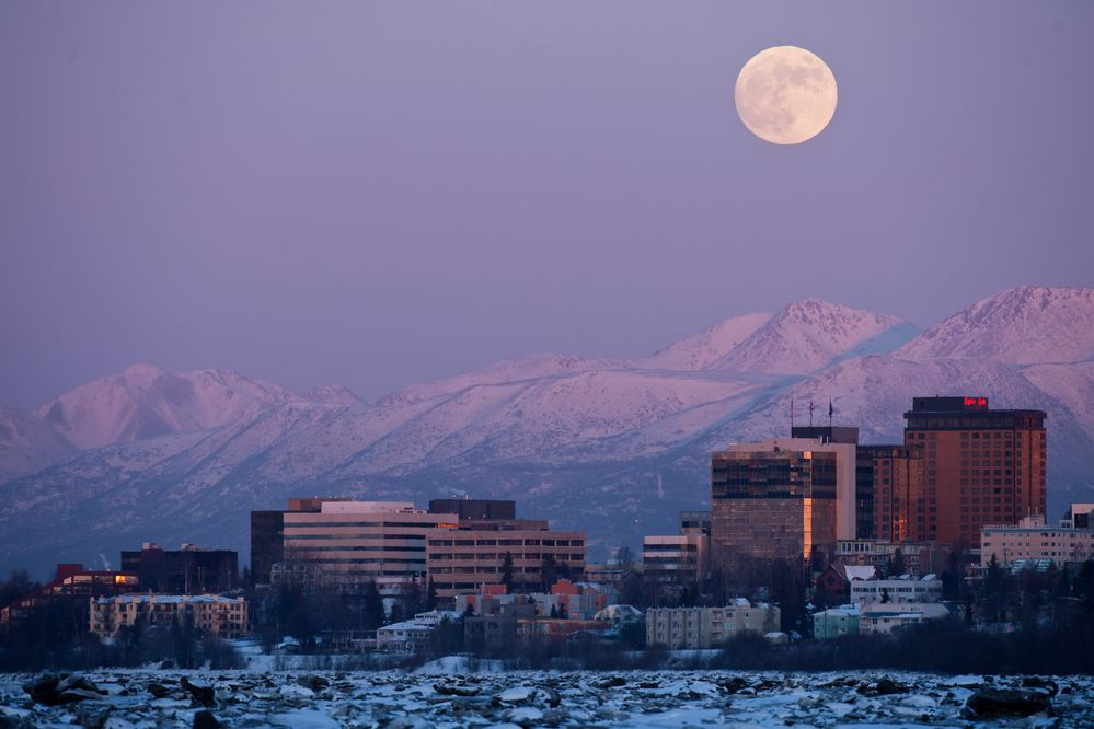 The full moon rises into view over downtown Anchorage Jan. 30, 2017 on the eve of the full lunar eclipse. (Marc Lester / ADN)