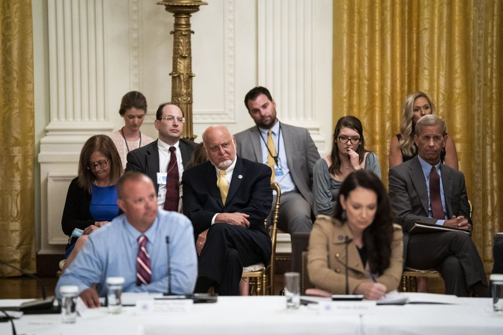 Centers for Disease Control Director Robert Redfield Redfield, with yellow tie at center, listens to the president in a July 7, 2020, roundtable discussion in Washington, D.C., about reopening schools. (Washington Post photo by Jabin Botsford)