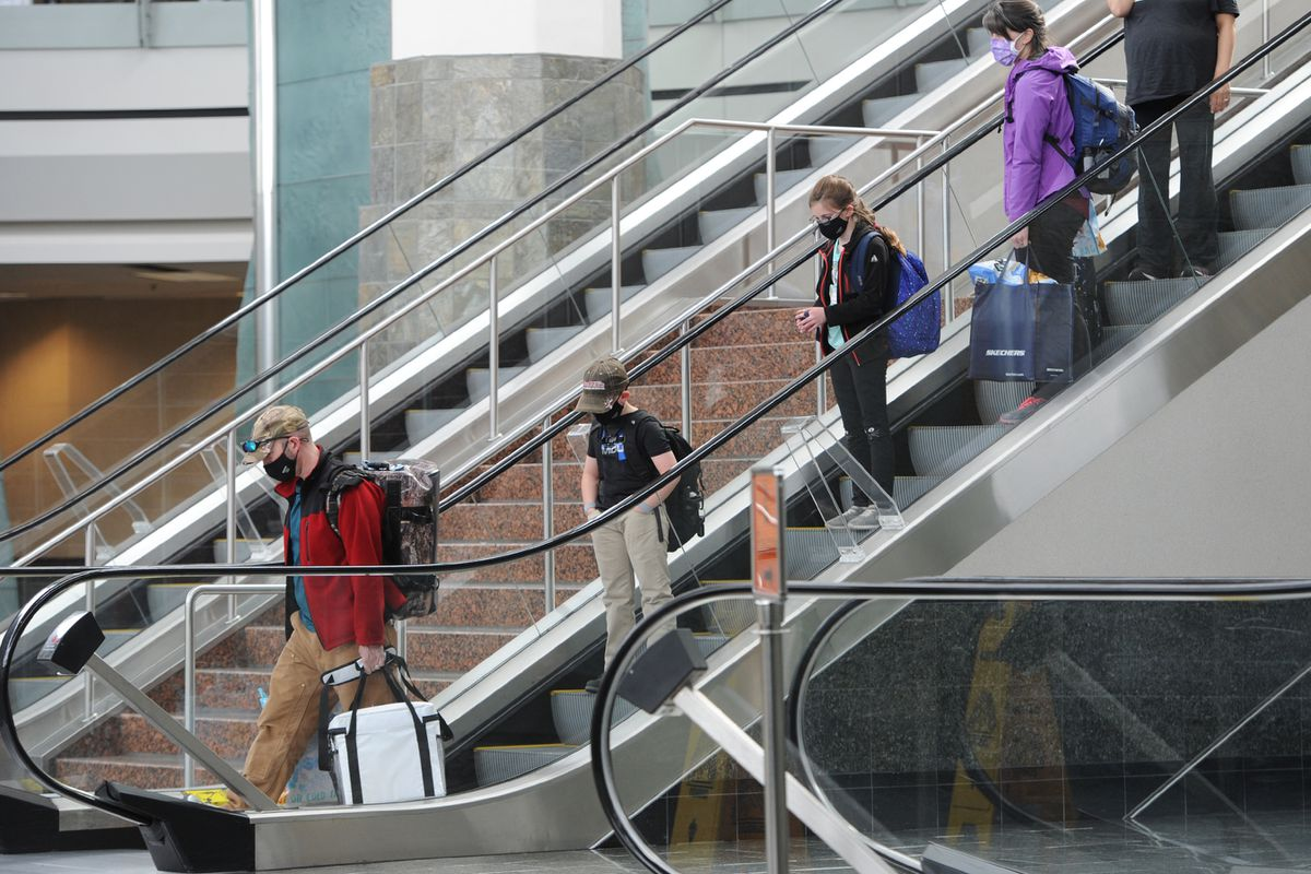 Air travelers arrive at Ted Stevens Anchorage International Airport on Tuesday, June 2, 2020. (Bill Roth / ADN)