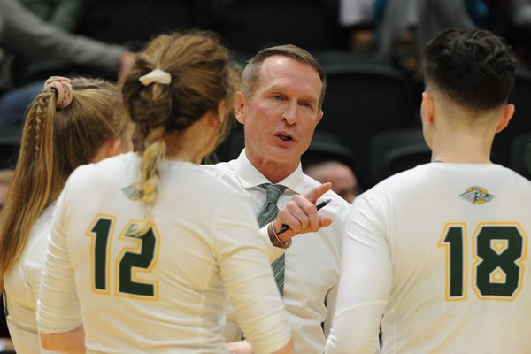 UAA head coach Chris Green talks to his players during the Seawolves' 3-0 home victory over Saint Martin's Saints at the Alaska Airlines Center on Thursday, Nov. 21, 2019. (Bill Roth / ADN)