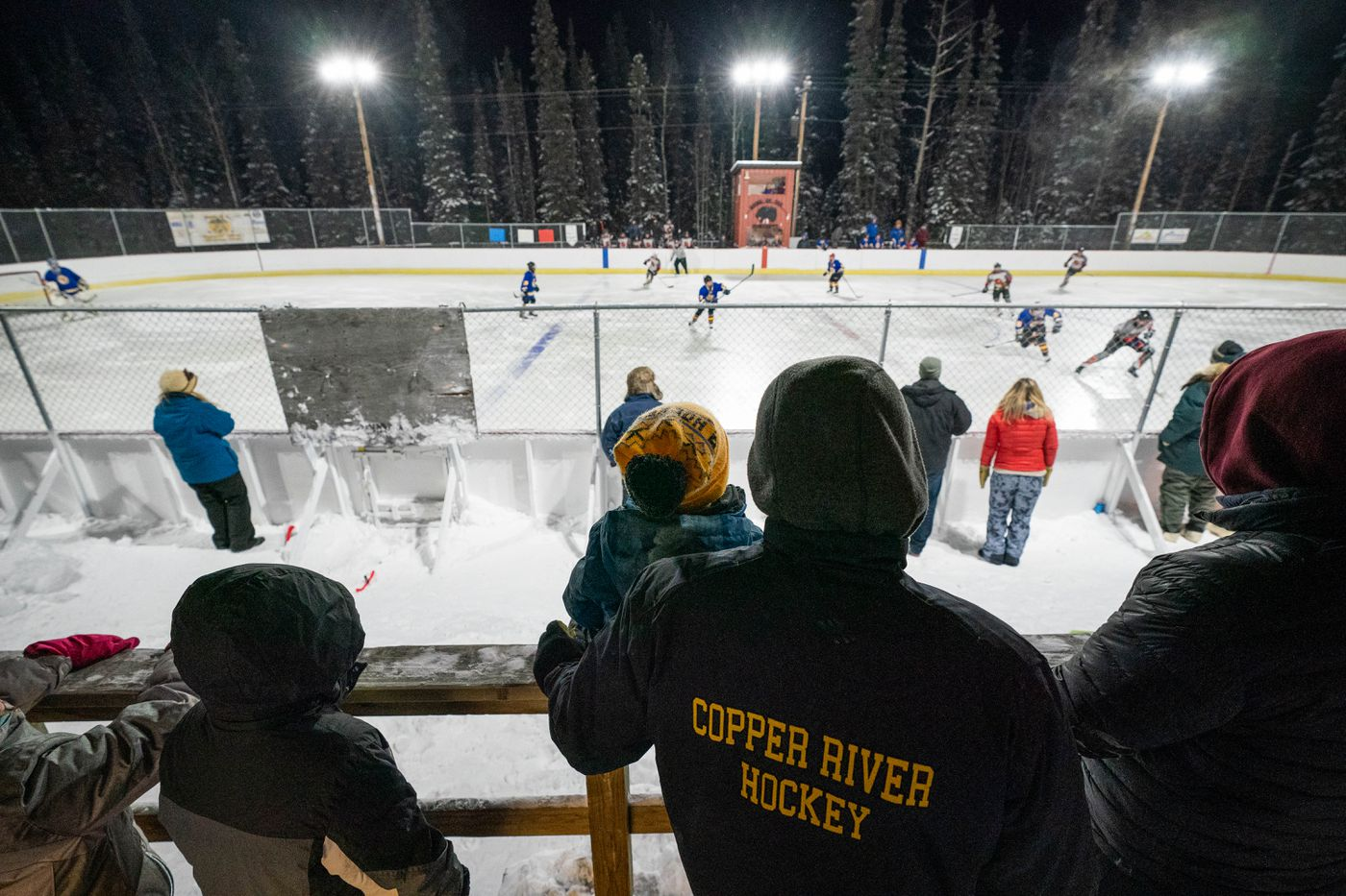 Spectators watch a hockey game in minus 10 temperatures. A game last month was cancelled when the temperature dipped to minus 31. (Loren Holmes / ADN)