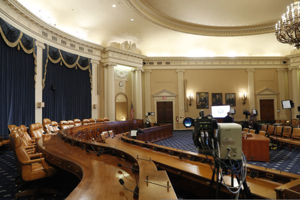 A television crew prepares in the hearing room where the House will begin public impeachment inquiry hearings Wednesday, on Tuesday, Nov. 12, 2019, on Capitol Hill in Washington. With the bang of a gavel, House Intelligence Committee Chairman Adam Schiff will open the hearings into President Donald Trump's pressure on Ukraine to investigate Democratic rival Joe Biden's family. (AP Photo/Jacquelyn Martin)