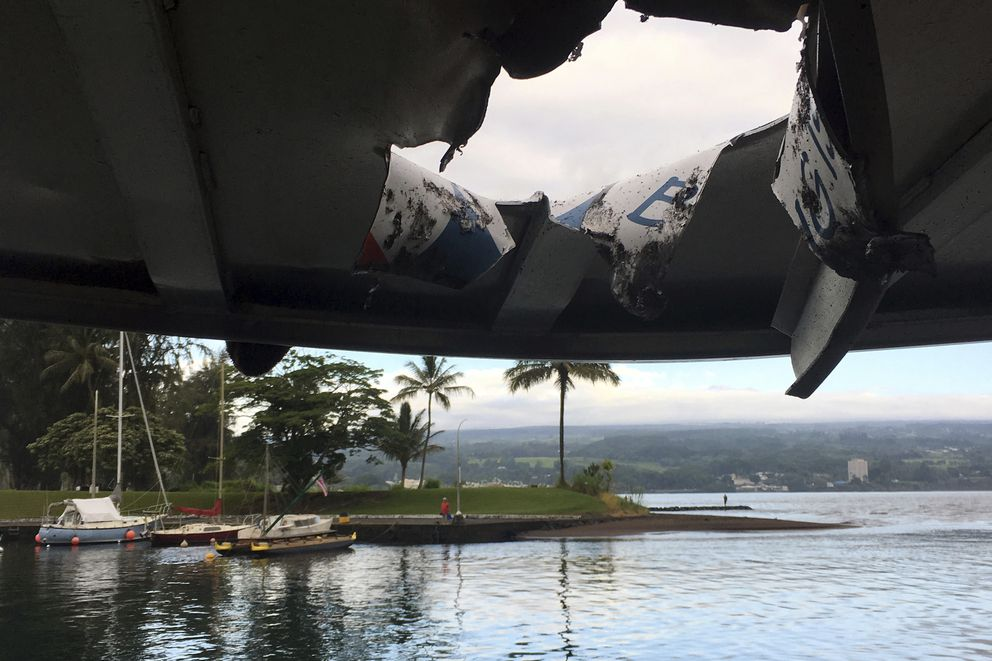 This photo provided by the Hawaii Department of Land and Natural Resources shows damage to the roof of a tour boat after an explosion sent lava flying through the roof off the Big Island of Hawaii Monday, July 16, 2018, injuring at least 23 people. The lava came from the Kilauea volcano, which has been erupting from a rural residential area since early May. (Hawaii Department of Land and Natural Resources via AP)