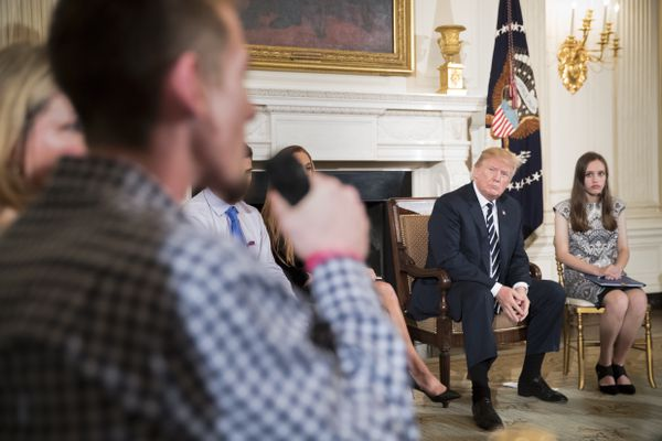 "President Donald Trump listens to Samuel Zeif, foreground, a survivor of the Marjory Stoneman Douglas High School mass shooting, during a discussion at the White House in Washington, Feb. 21, 2018. ""We're going to do something about this horrible situation,"" Trump said at the event's outset, adding that his administration would be ""very strong on background checks."" (Tom Brenner/The New York Times)"